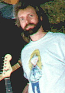Dave Michael Valentine sporting Larry Norman cartoon on shirt