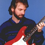 Dave Michael Valentine with red and whit fender stratocaster